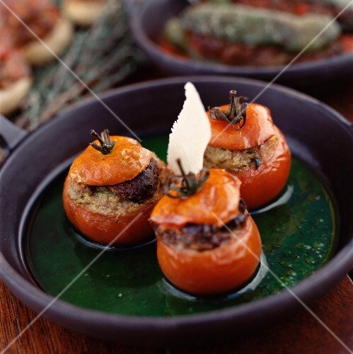 Stuffed tomatoes with Parmesan in a green sauce