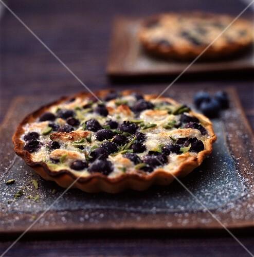 Clafoutis-style blueberry and pistachio tart