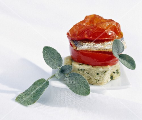 Sage cake with braised tomatoes and sardines