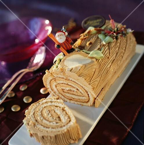 Praline rolled Christmas log cake