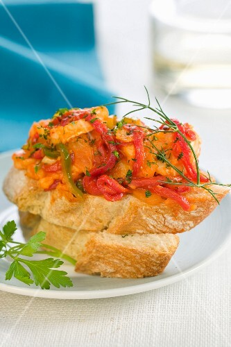 Tomato cod and red peppers on a bite-size slice of bread