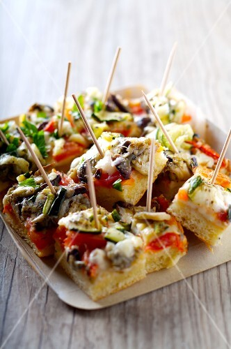 Small pieces of eggplant and zucchini pizza