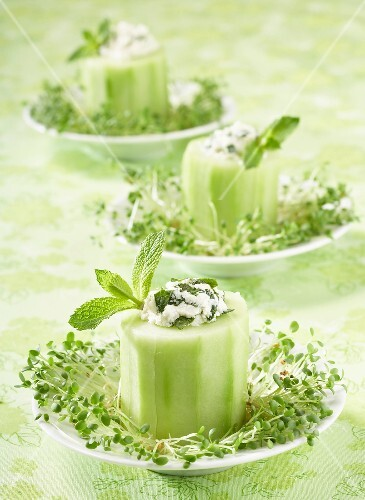 Slices of cucumber stuffed with fromage frais and fresh mint