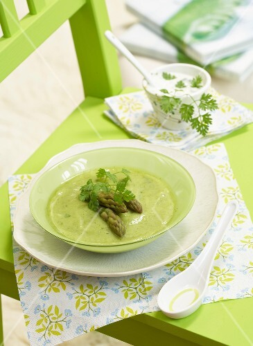 Cream of green asparagus soup with herbs
