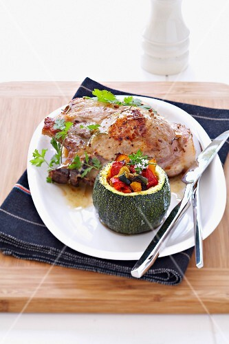 Porc chop marinatedin cider and stuffed round zucchini