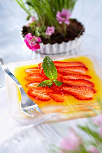 Strawberry carpaccio with mango coulis