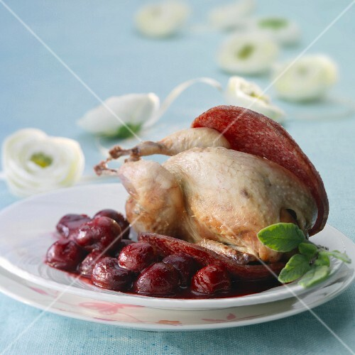 Quail with salami and stewed cherries