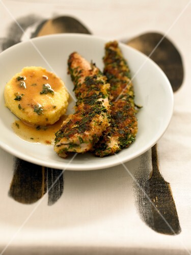 Sliced chicken breasts in breadcrumbs and herbs