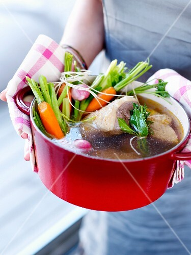 Stringed roast beef with vegetables in a casserole dish
