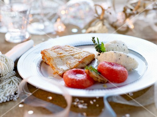 Pan-fried bass fillet with mashed potato quenelles and acidulated plums