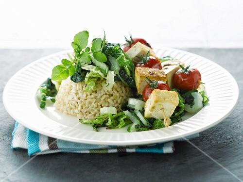 Tofu and cherry tomato kebab, rice and cabbage