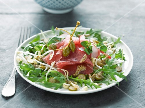 Red tuna carpaccio, rocket and beansprout salad with capers
