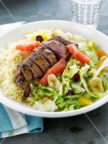 Beef fillet, semolina and mixed salad with fresh fruit