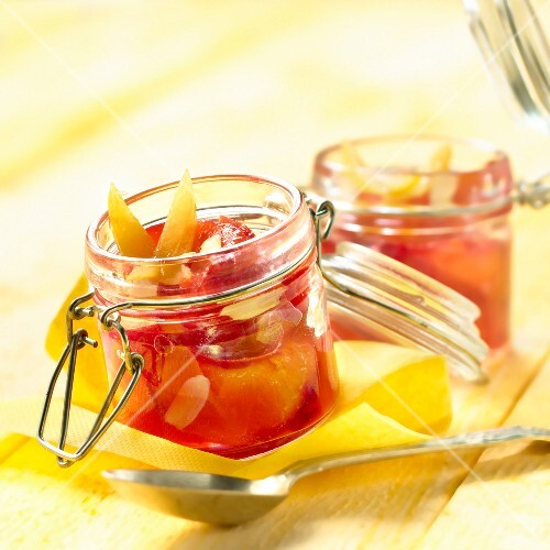 Stewed plums with thinly sliced almonds and confit citrus