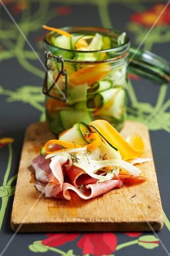 Sliced raw ham with marinated vegetables