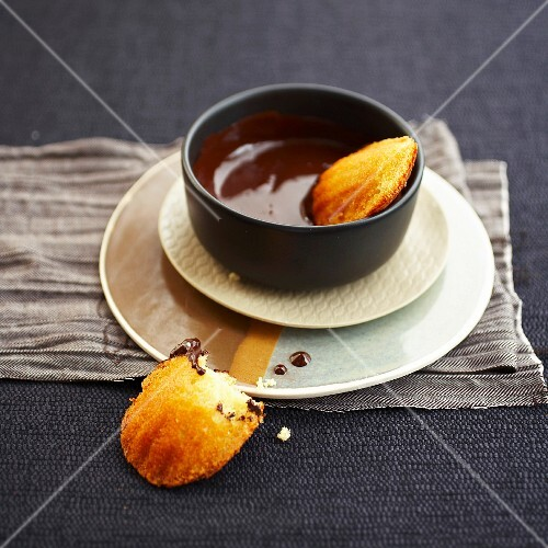 Madeleines with melted chocolate