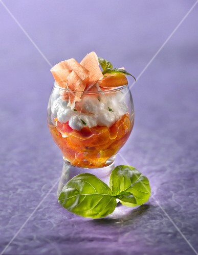 Cream cheese mousse, basil, thinly sliced raw ham and stewed tomato Verrine