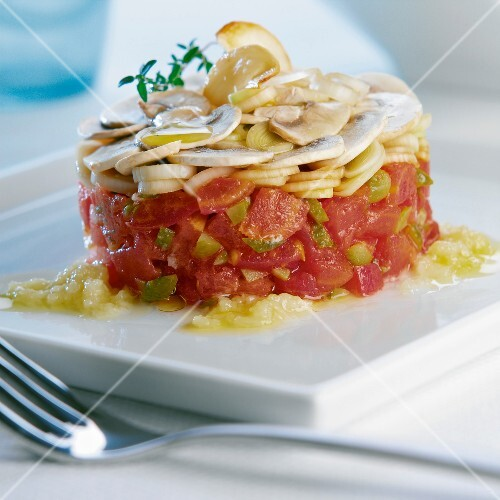 Tomato and green olive tartare with button mushrooms