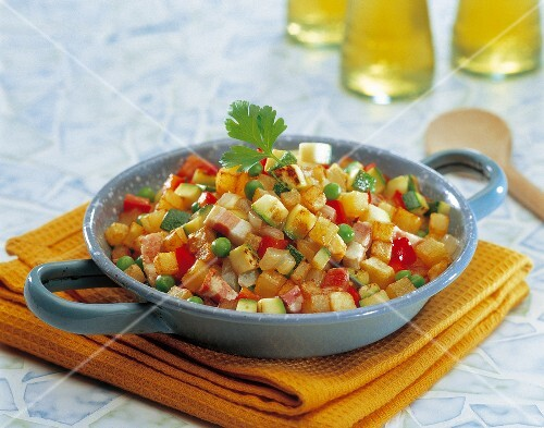 Pan-fried diced potatoes with vegetables and bacon