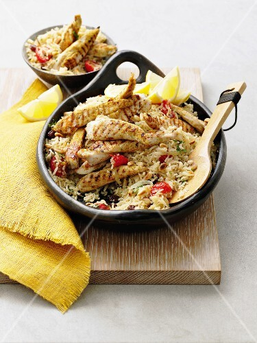 Pilaf rice with sliced chicken breasts