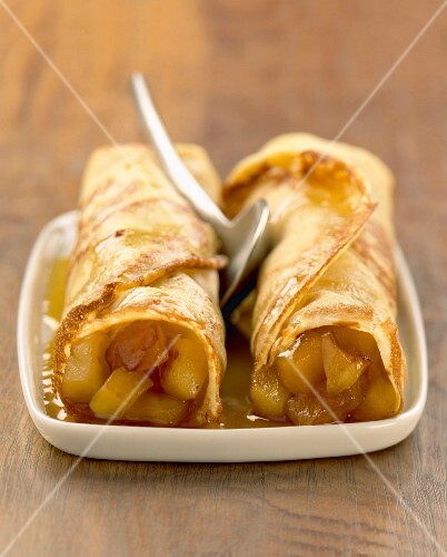 Rolled pancakes with stewed apple filling
