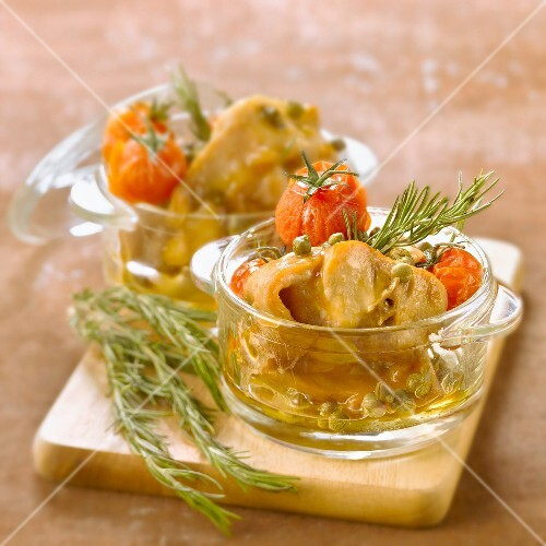 Rabbit stewed with tomatoes,capers and rosemary