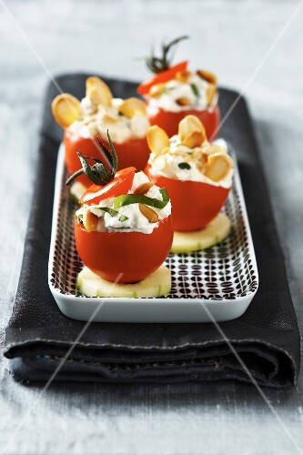 Cherry tomato stuffed with cream cheese and dried fruit