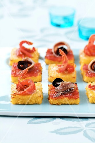 Squares of polenta with anchovies