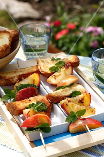 Nectarine,grilled brioche and mint brochette