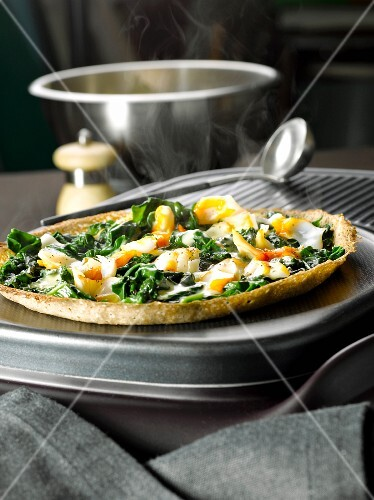 Buckwheat pancake with haddock and spinach