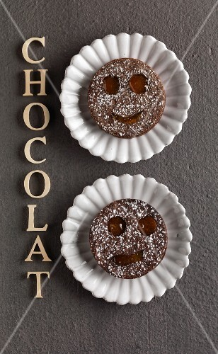 Funny faced chocolate shortbread cookies with marmelade filling