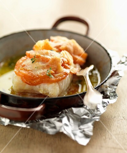 Braised fillet of pollock with tomatoes