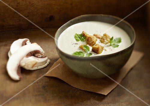 Cream of mushroom soup with diced foie gras