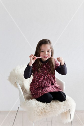 Young girl playing with candy