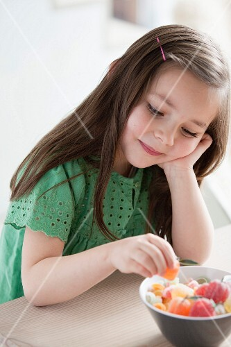 Young girl eating candies