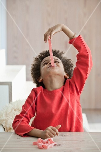 Boy eating playing and eating candy