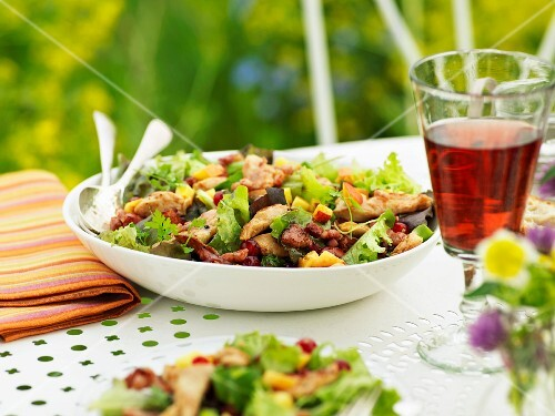 Guinea-fowl salad on a table outdoors