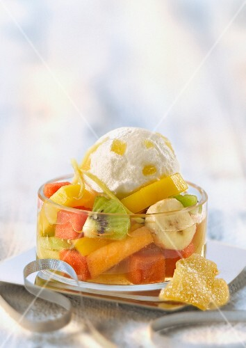 Exotic fruit salad with Champagne, crystallized ginger yoghurt ice cream