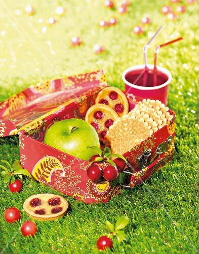 Cherry tartlets,waffles and an apple in a lunch box