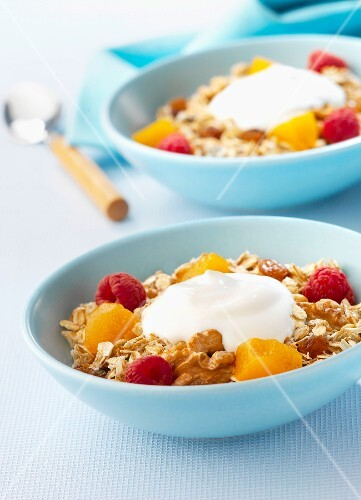 Muesli with raspberries and yoghurt for breakfast