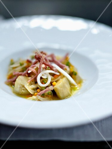 Artichokes a la barigoule with squid and raw ham