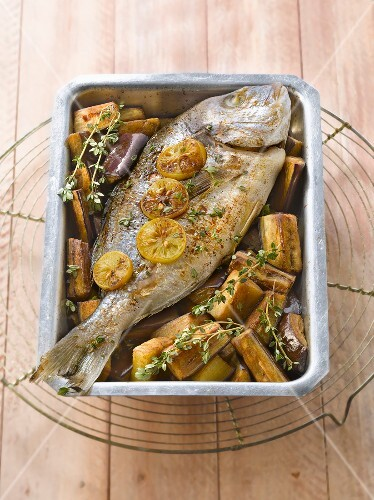 Oven-baked sea bream with confit citrus and eggplants
