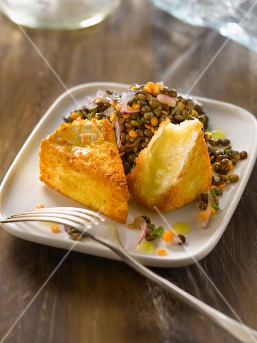 Lentil salad and fried breaded Camembert