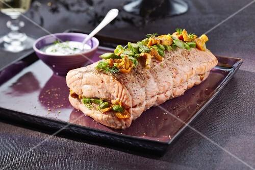 Roast salmon stuffed with asparagus and mushrooms