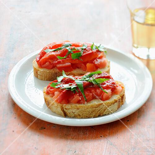Marinated pepper and tomato bruschettas