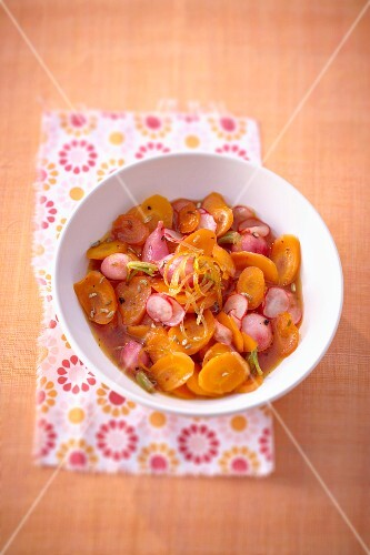 Sweet and salty carrot and radishes in grape fruit syrup salad