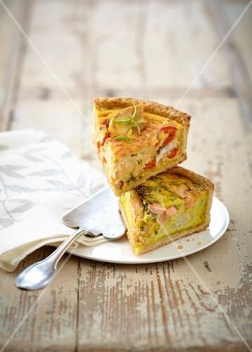 Slice of chicken and pepper savory tart and salmon and cauliflower savory tart