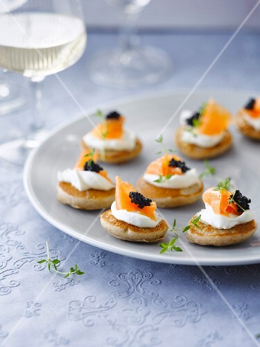 Salmon and fish roe on mini blinis
