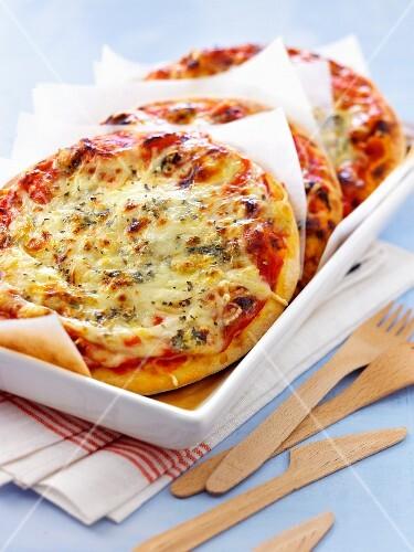 Three cheese pizzas