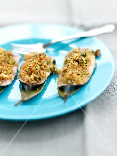 Sardines stuffed with pine nuts,bread crumbs and raisins,bay leaves and orange sauce